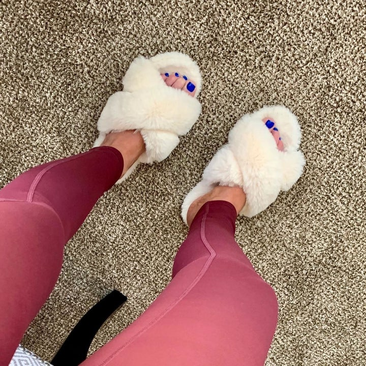 Reviewer wearing slippers in the shade beige
