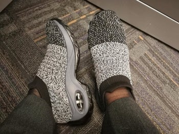 Reviewer wearing sock-sneakers in the shade gray