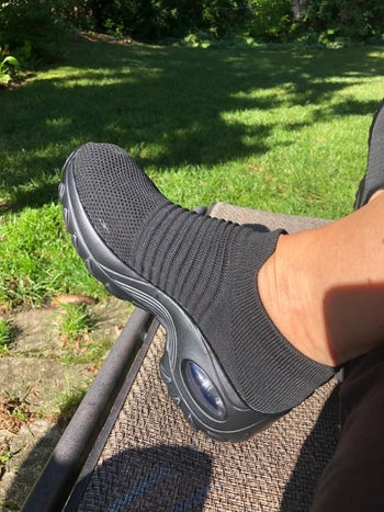 Reviewer wearing sock-sneakers in the shade pure black