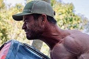 Chris Hemsworth moving a tire
