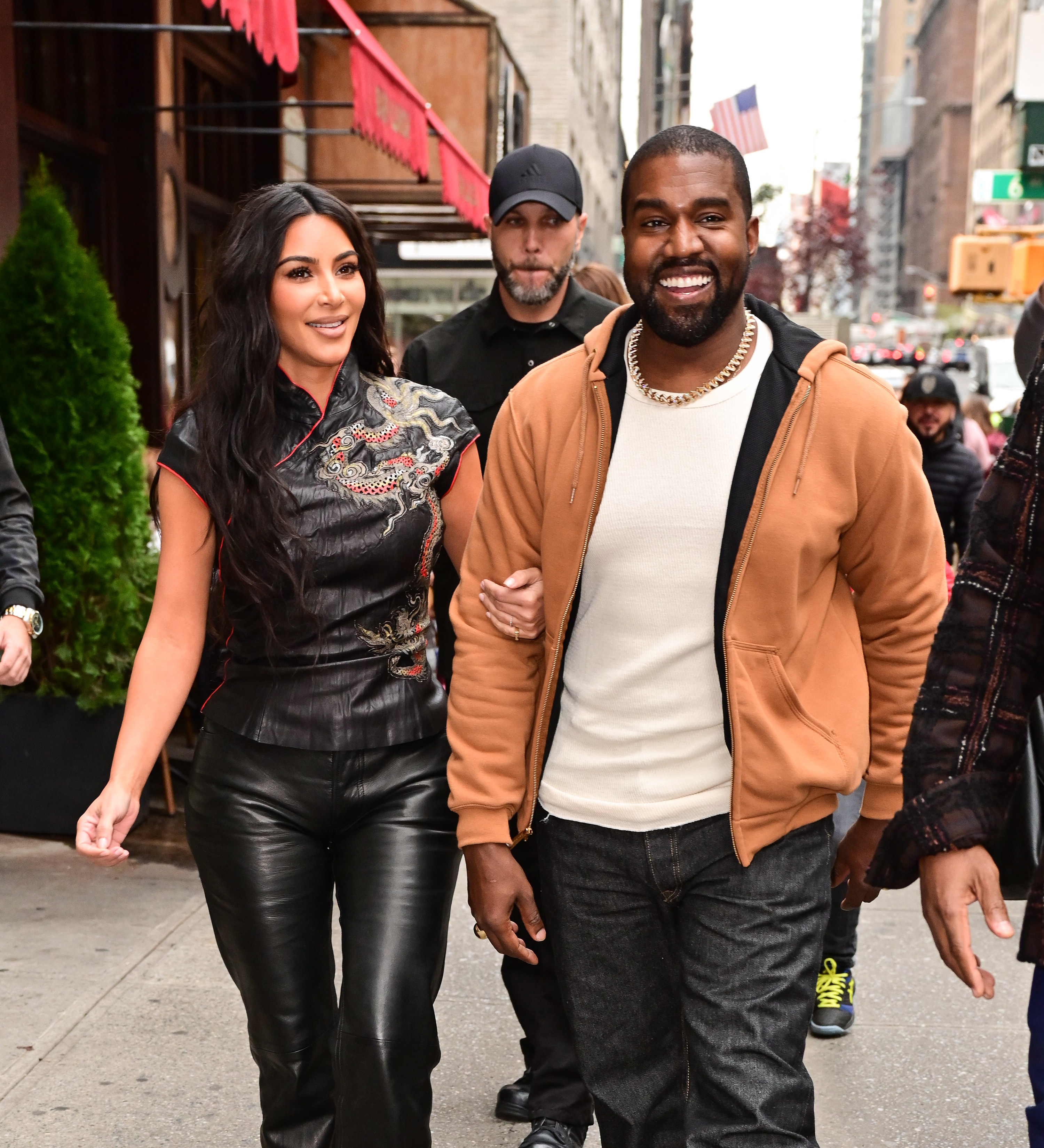 Kim Kardashian West and Kanye West walk along 57th Street on October 25, 2019 in New York City