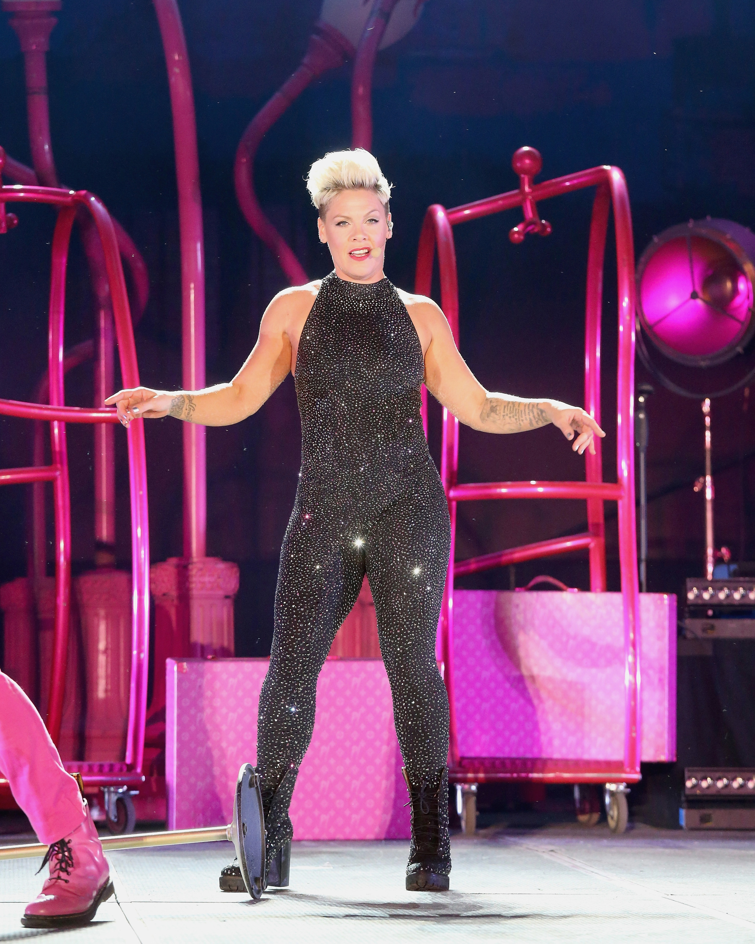 P!nk performs on stage in a sparkly one-piece