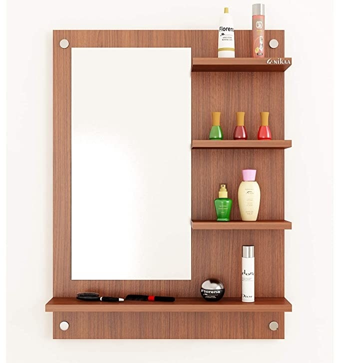 Wooden stand with mirror and shelves on it.