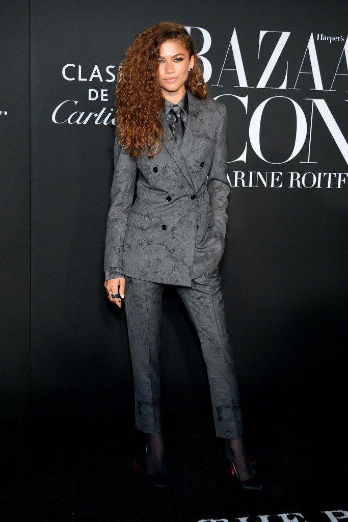 Zendaya in a floral patterned double-breasted suit with a tie and button up beneath