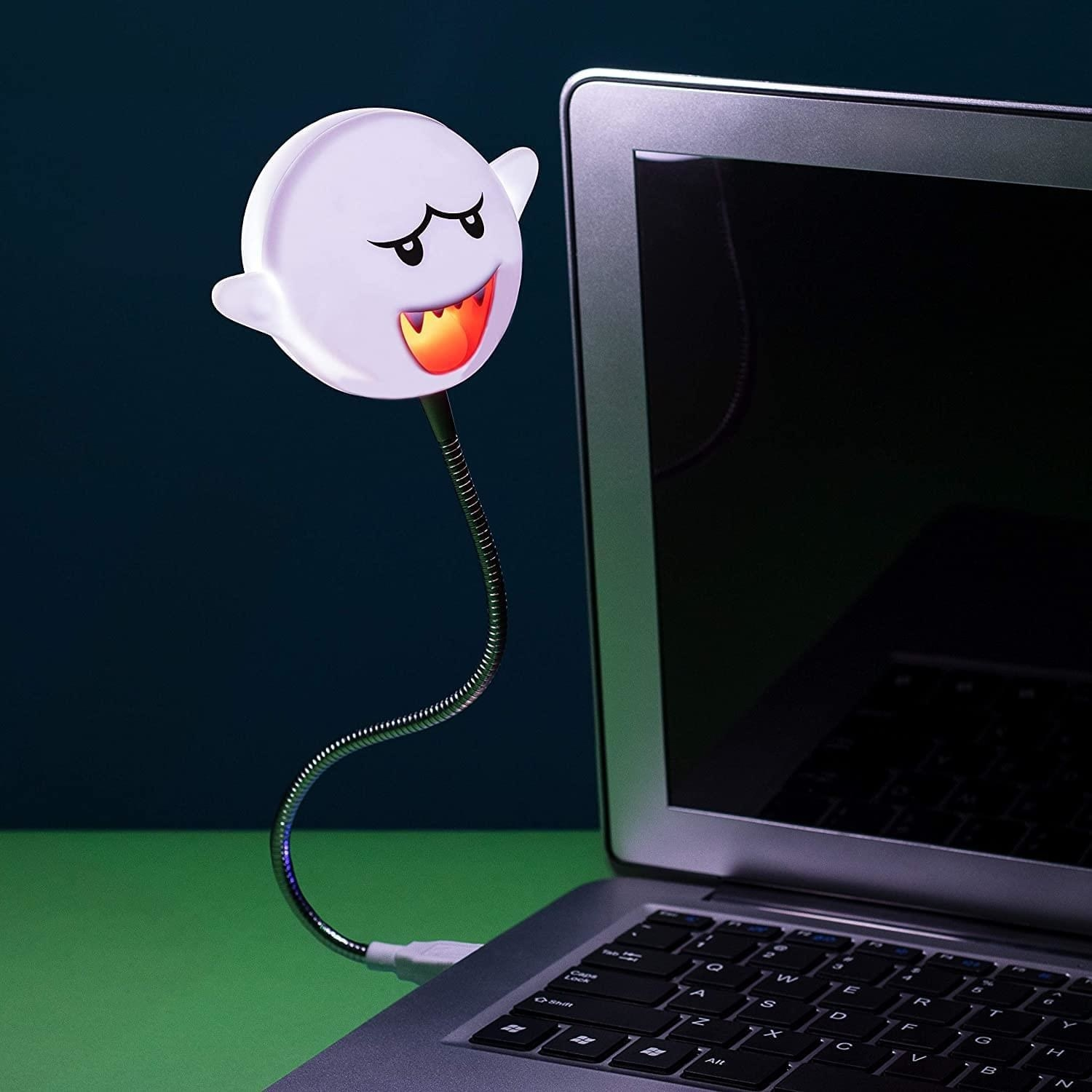 small nintendo ghost on bendy cord that connects to usb port on laptop