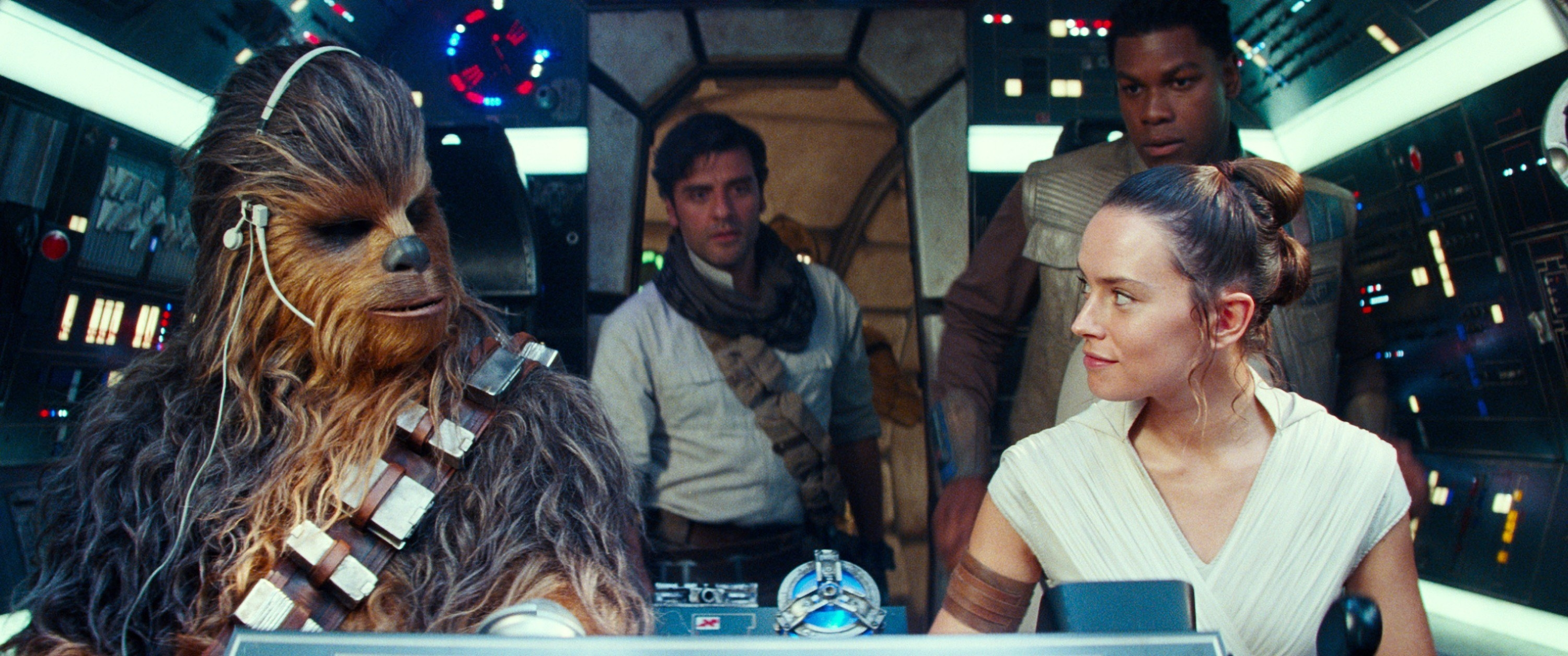 Joonas Suotamo as Chewbacca, Daisy Ridley as Rey; background from left: Oscar Isaac as Poe Dameron, John Boyega as Finn