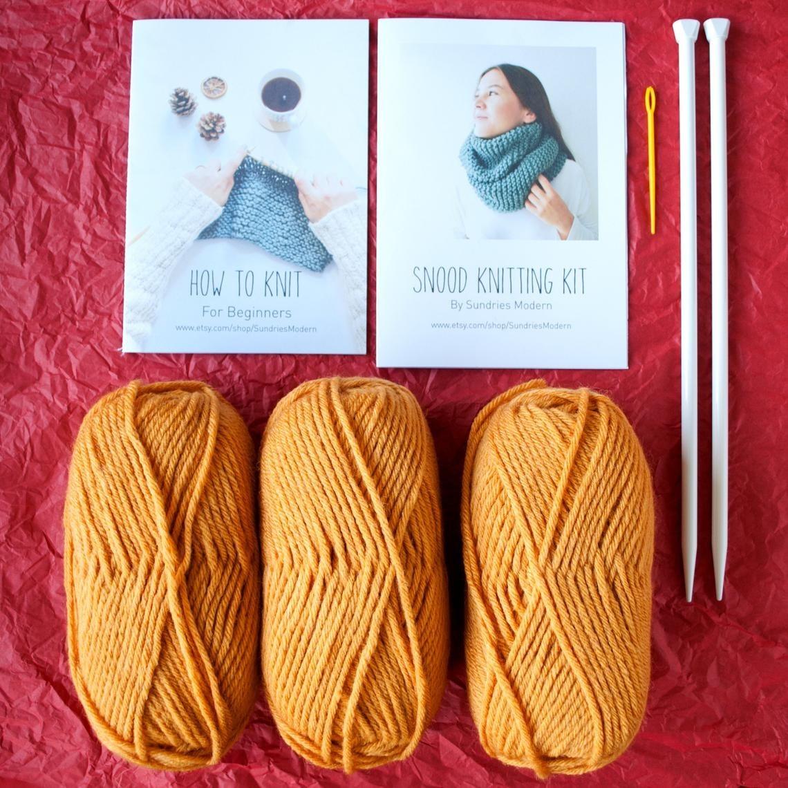 Three balls of yarn, knitting needles, and instructions