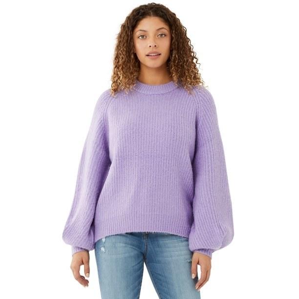 Model in purple balloon sleeve sweater