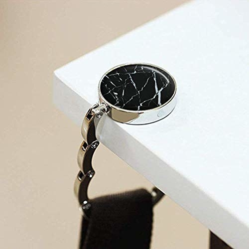 Metal foldable hook with a marble design on top.