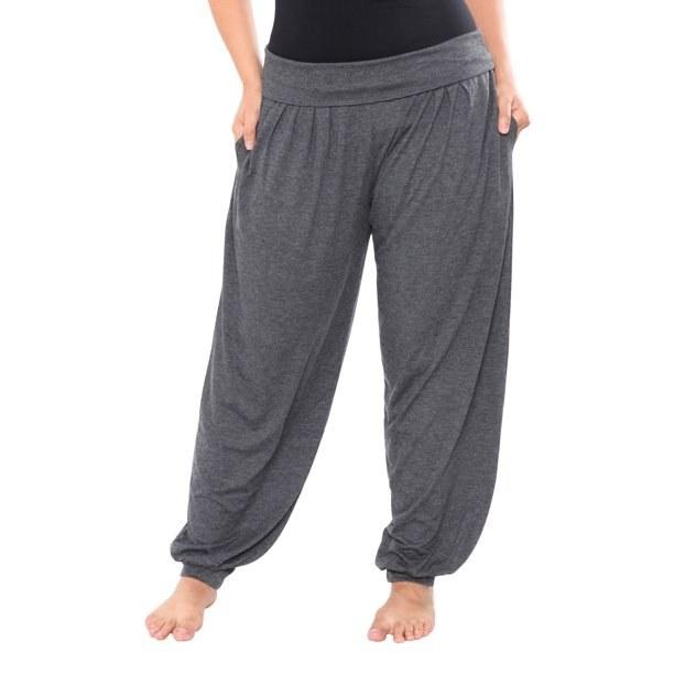 Model in gray harem pants