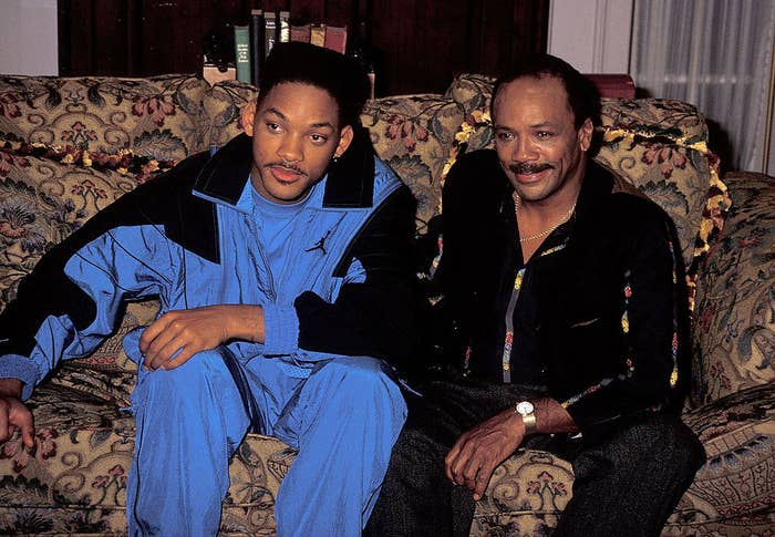 """Will Smith and Quincy Jones sitting on the couch on the set of """"The Fresh Prince of Bel-Air"""""""