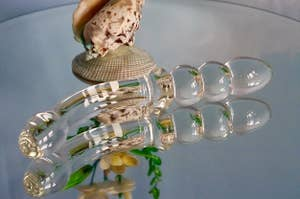 The glass toy lying on a mirrored table