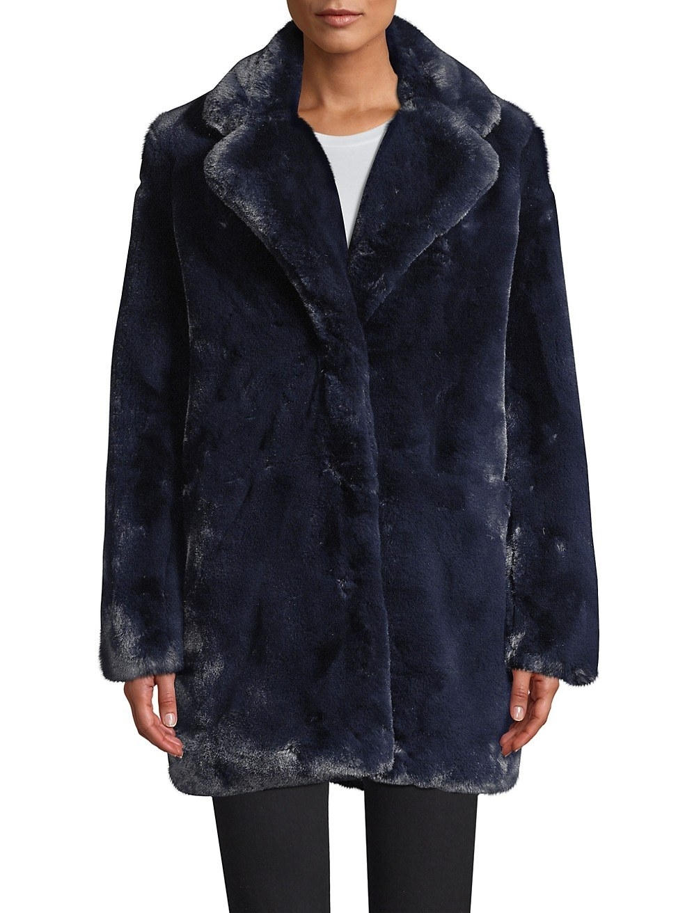 Model in the hip-length coat