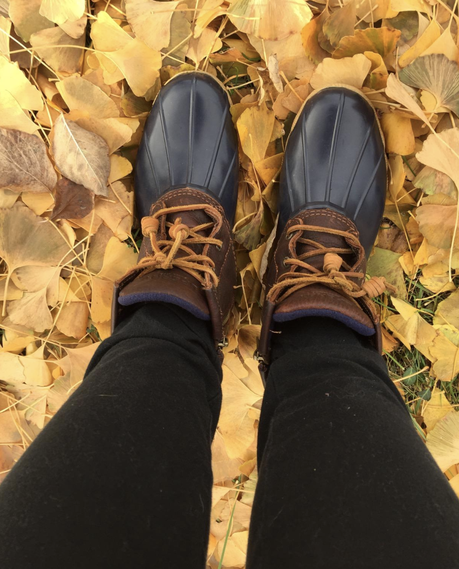 Reviewer image of lace up boots with brown from top of foot to ankle and navy rubber on the feet