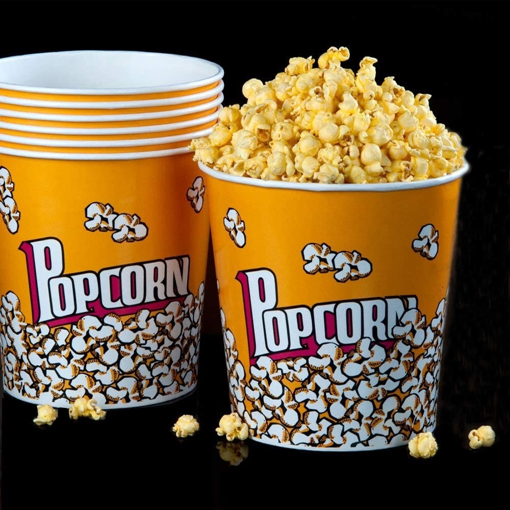 five buckets stacked and one full of popcorn
