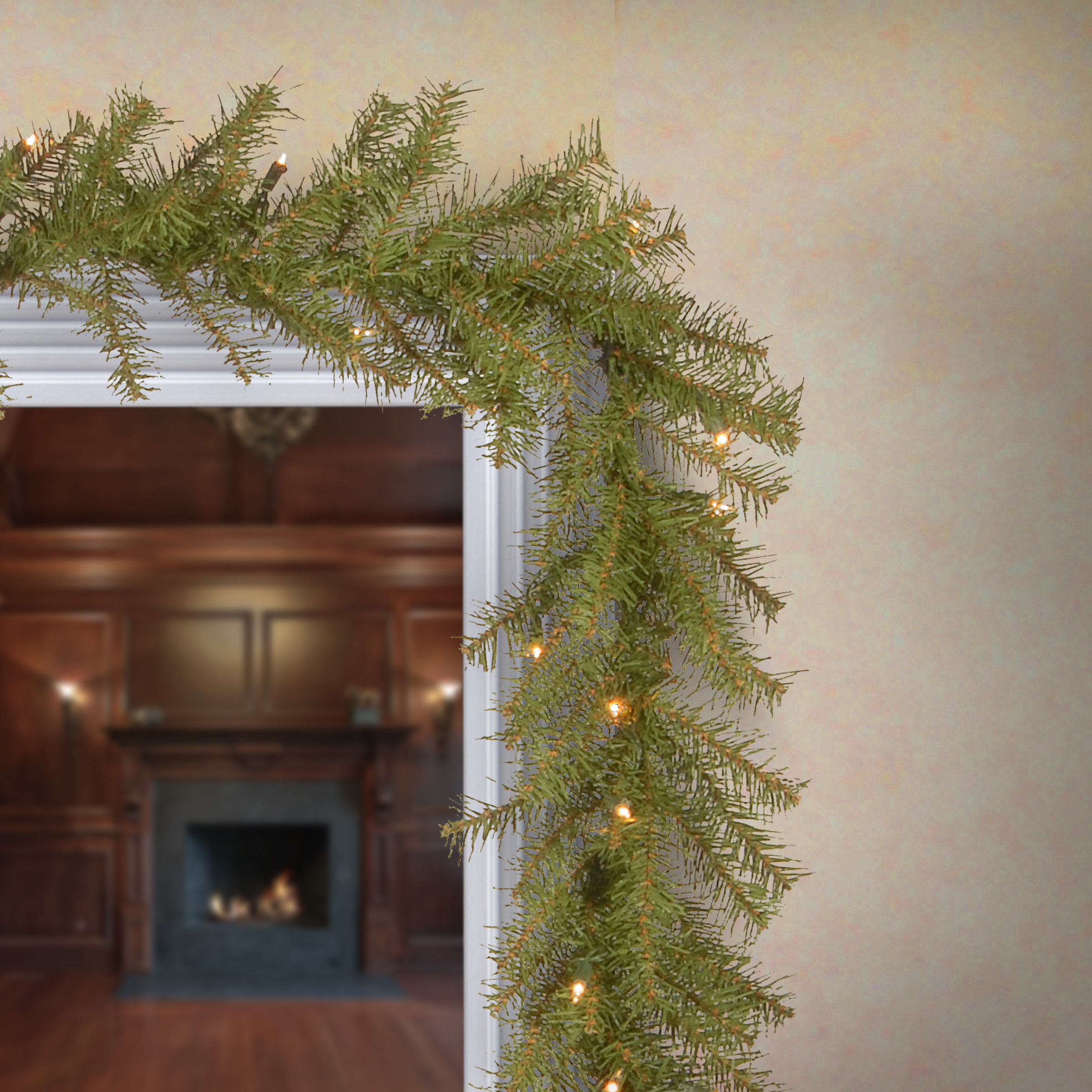 The garland draped over an entryway with lights turned on