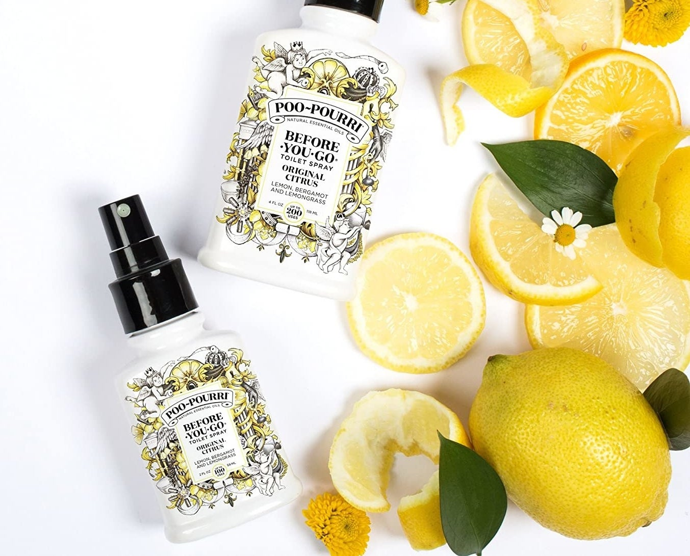 bottles of poo-pourri next to lemons