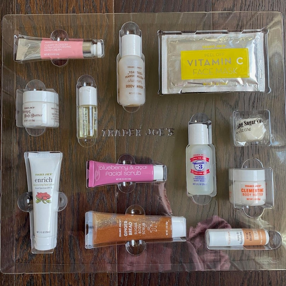The contents of the Trader Joe's beauty advent calendar, which includes 12 mini sample-sized items.