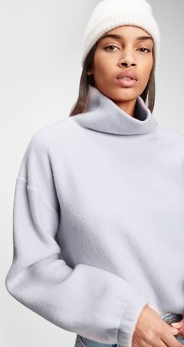 model wearing grey fleece turtleneck