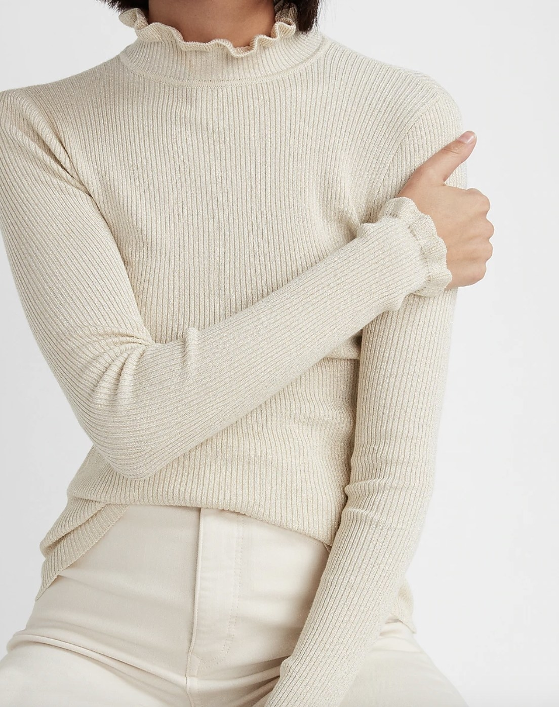 A metallic ribbed mock-neck sweater in white