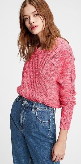 model wearing a pink pullover