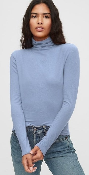 model wearing a blue high neck tee