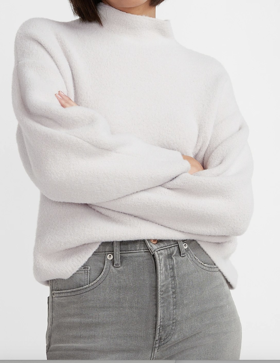 A cozy mock neck sweater in white