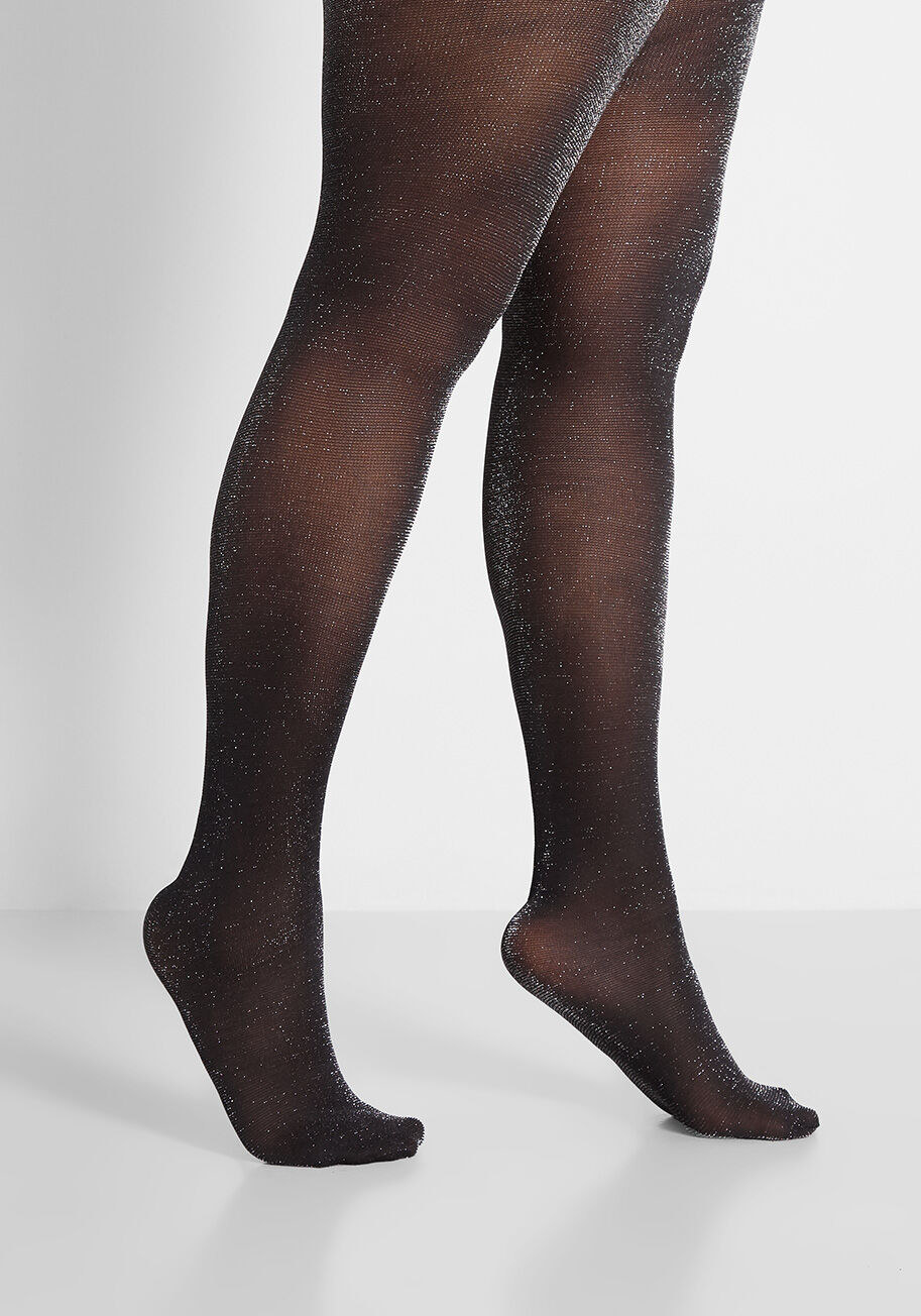 model wearing the black tights with silver flecks