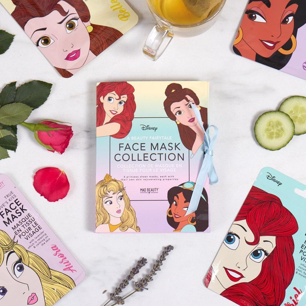the face masks that are themed after belle, aurora, jasmine, and ariel