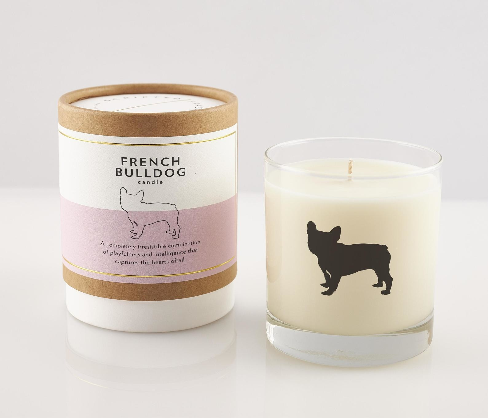 the white candle with a pink and cardboard cover that has a French Bulldog decal