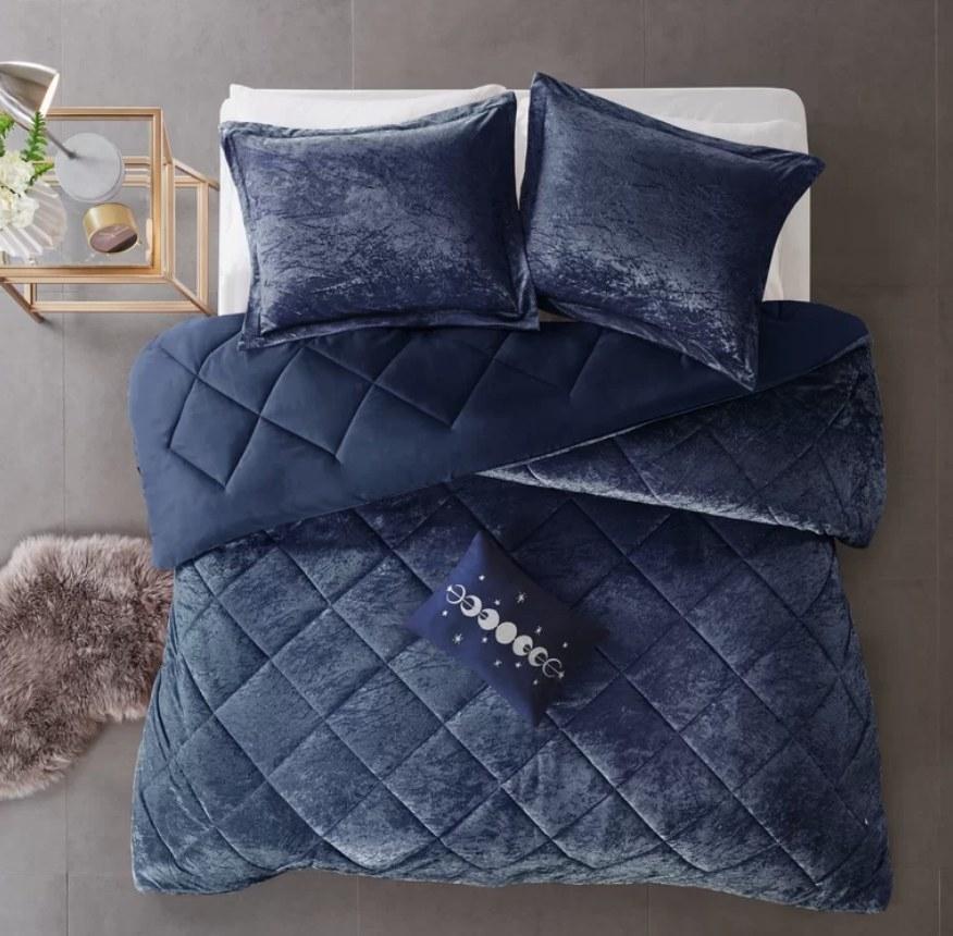 Dark blue velvet comforter with matching shams