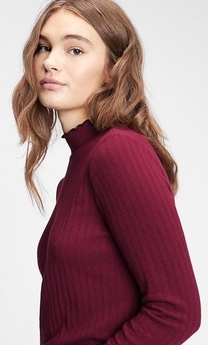 model wearing red mockneck tee