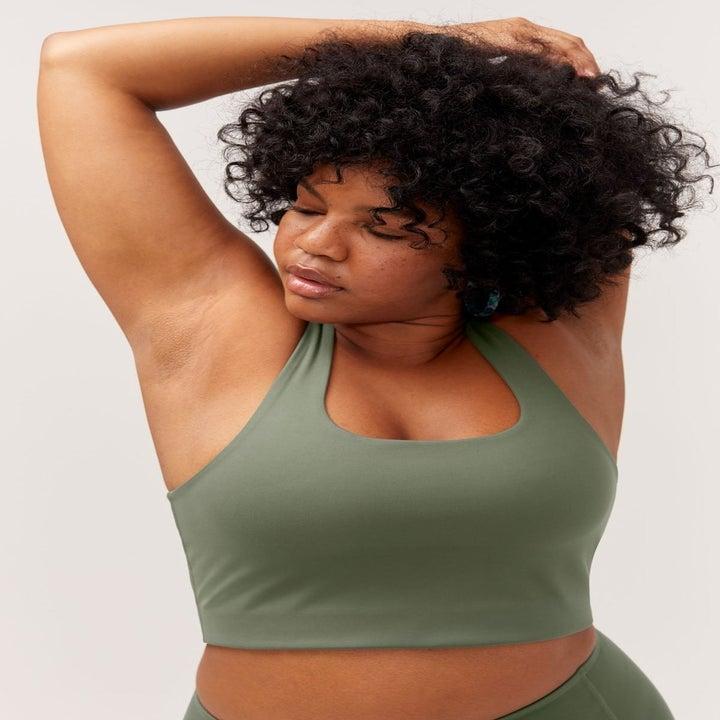 model wearing the green sports bra