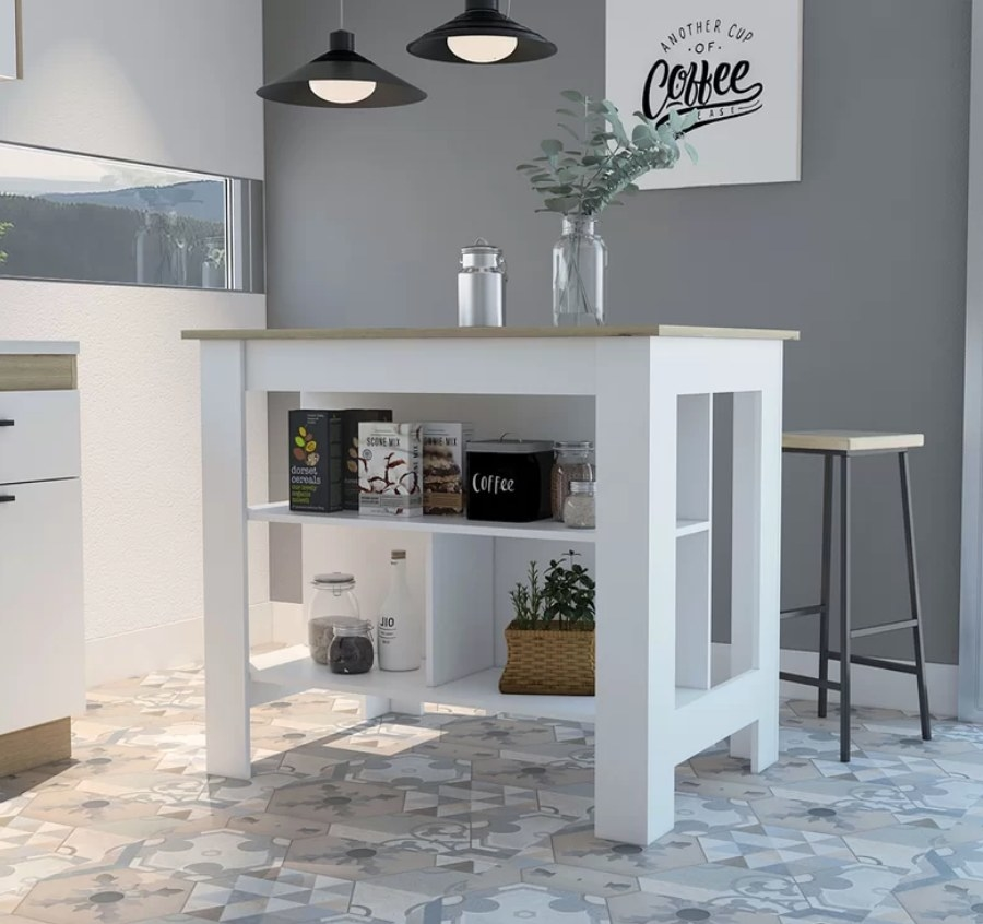 White kitchen island with shelving on the bottom, wooden table top, and bar stool