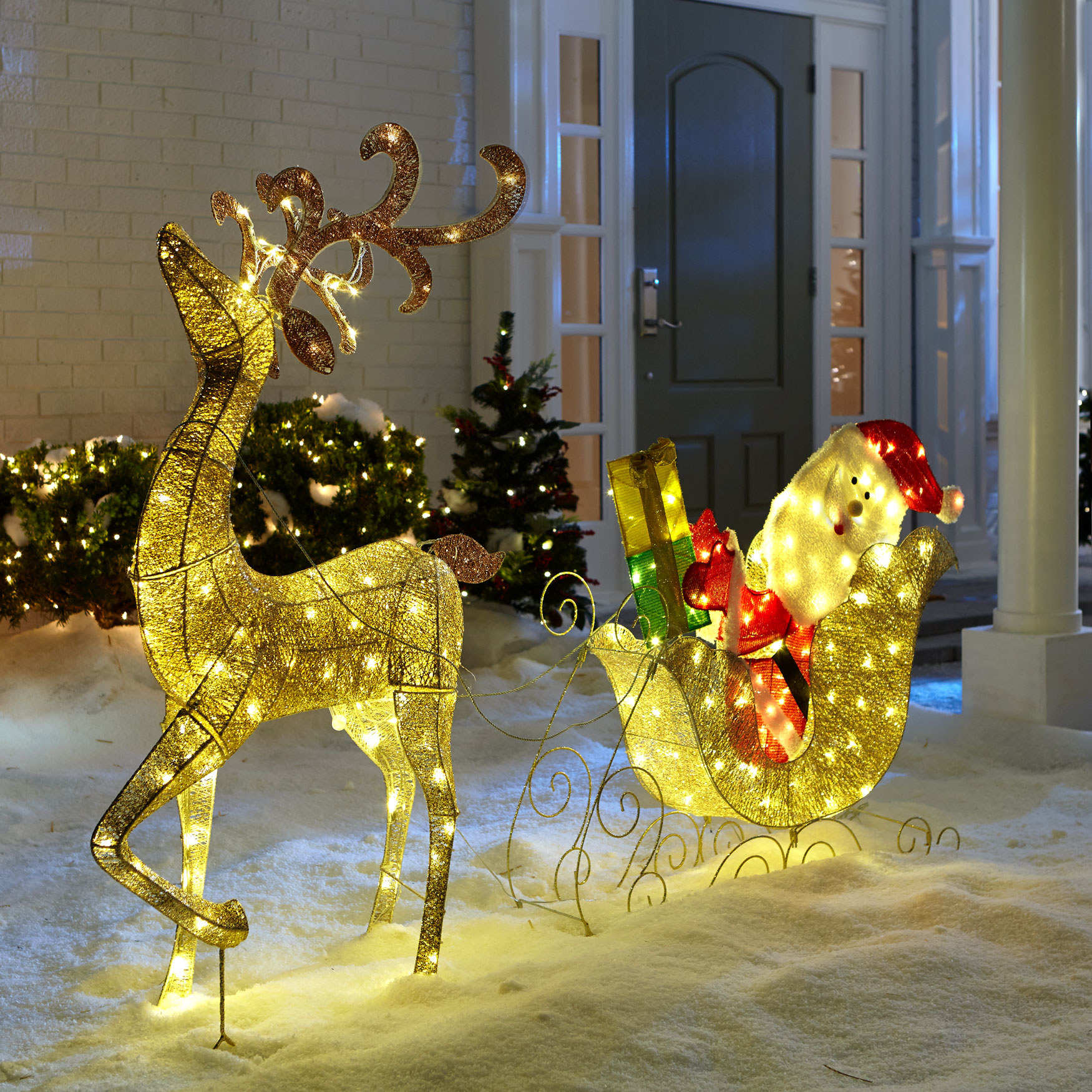 The reindeer and Santa in his sleigh lit up to show size and brightness