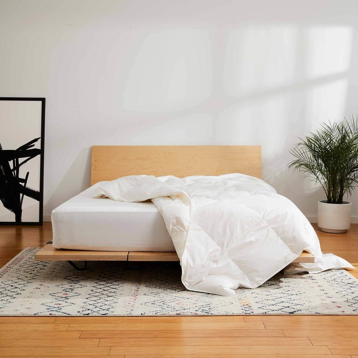 the down alternative comforter on a bed