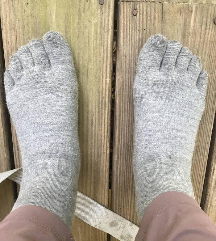 writer wearing light grey toe socks