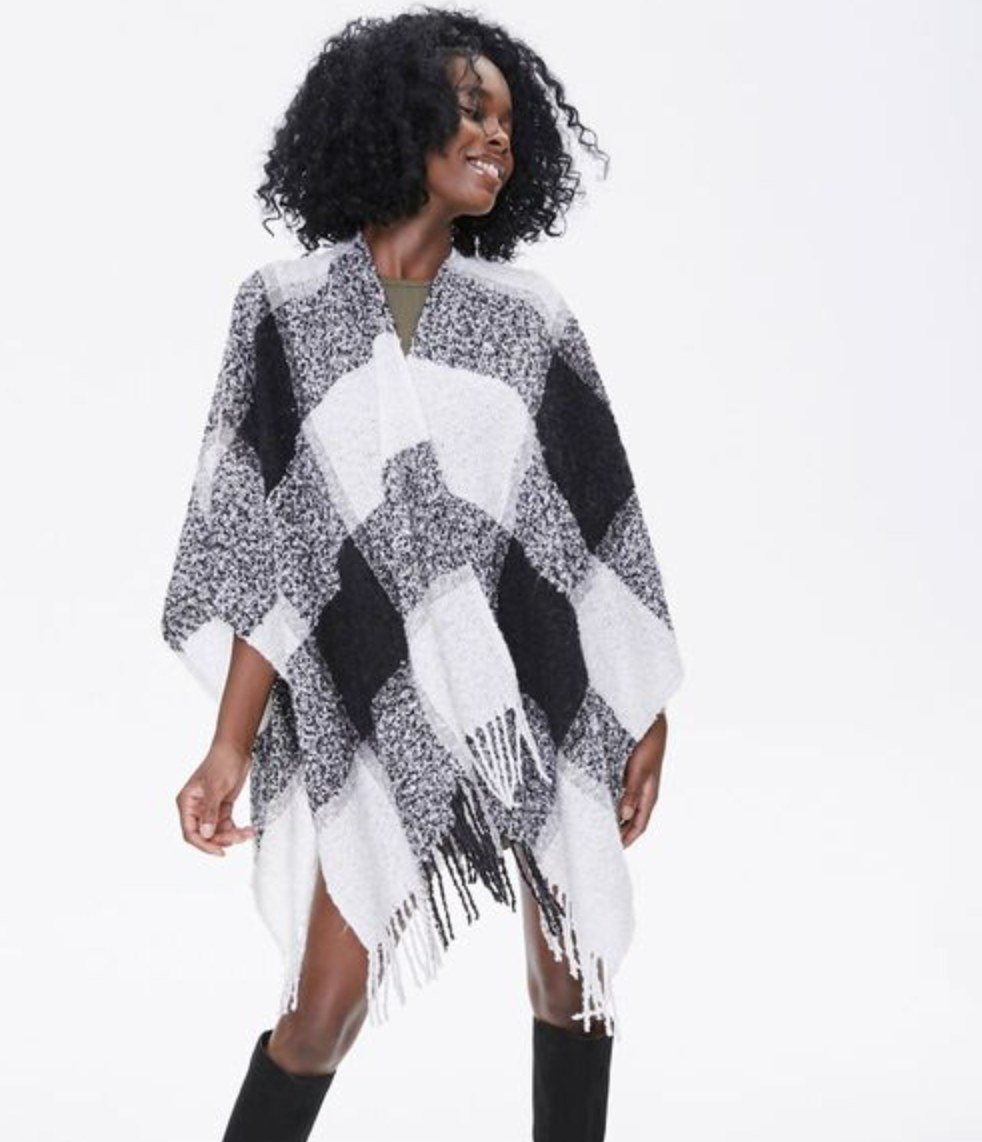 Model is wearing a black and white poncho