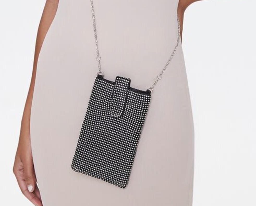 Model is wearing a black rhinestone crossbody pouch
