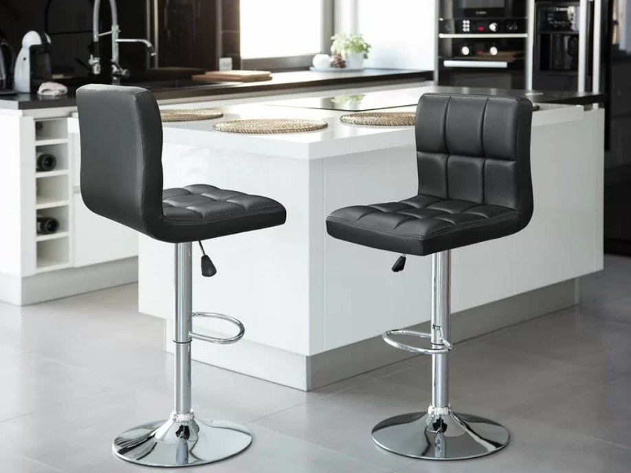 Two black cushions bar stools with silver base