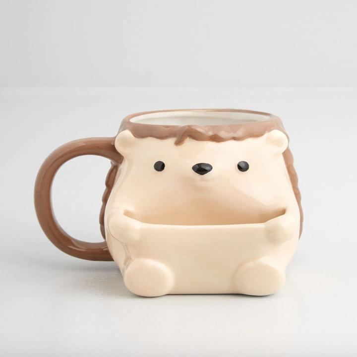 the front of the mug shaped like a hedgehog body