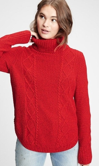 model wearing bright red sweater