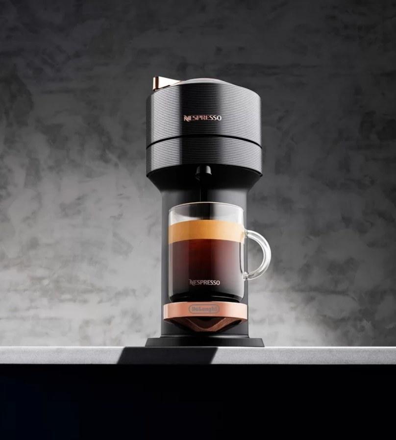 Nespresso filling glass mug of espresso
