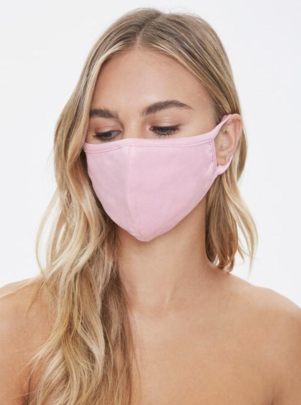 Model is wearing a light pink mask
