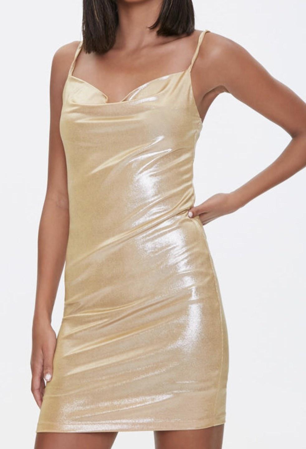 Model is wearing a gold mini dress