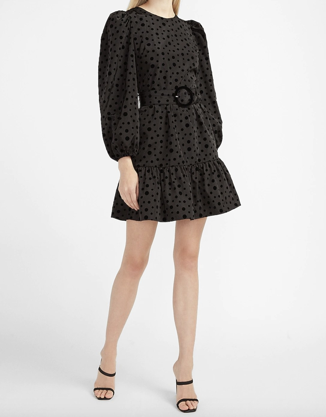 A belted polka dot dress with a circular belt in black