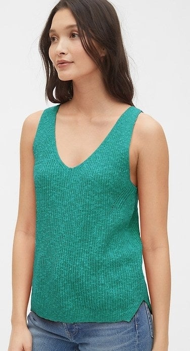 model wearing green sweater tank top
