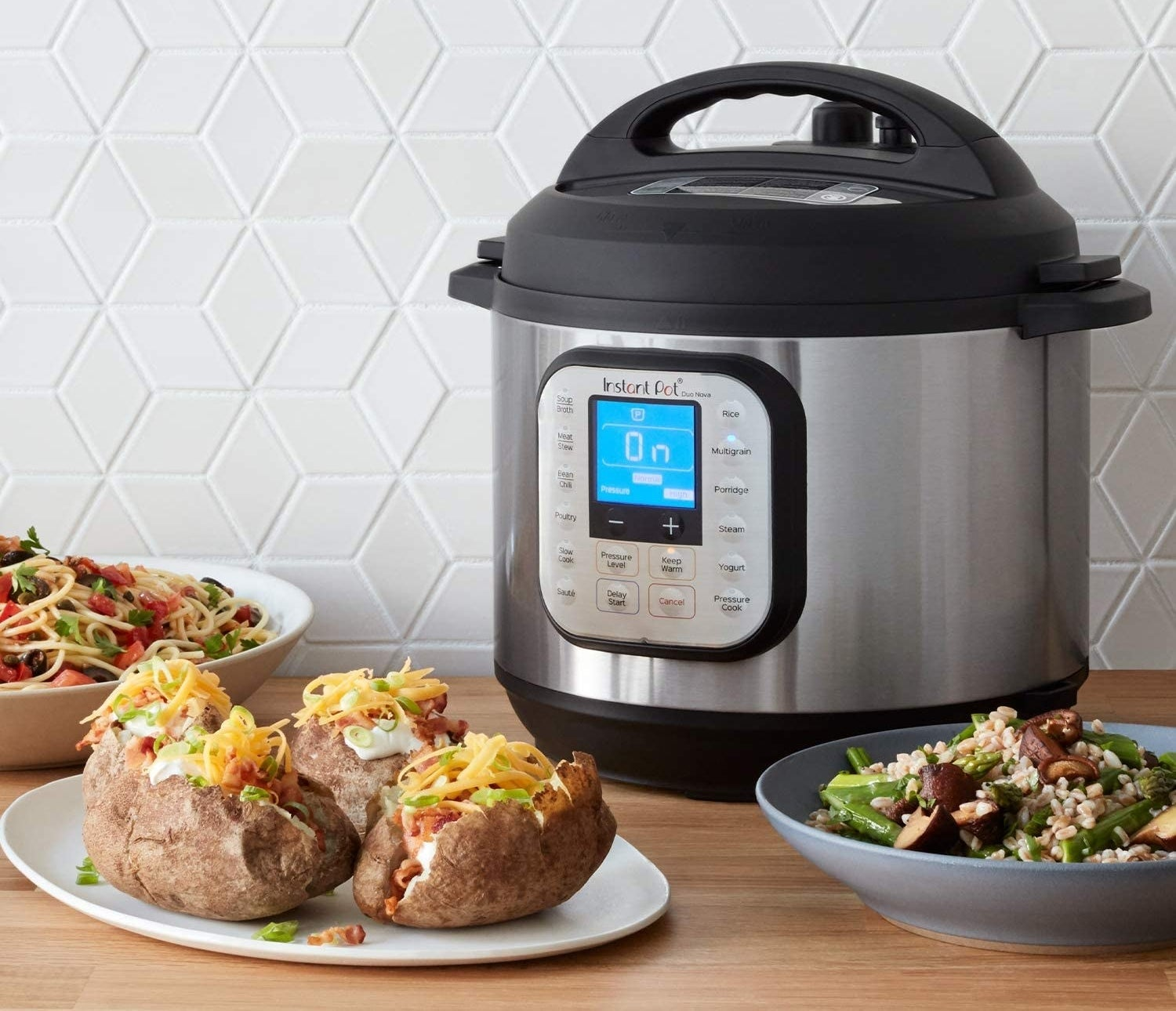 the instant pot duo surrounded by plates of food