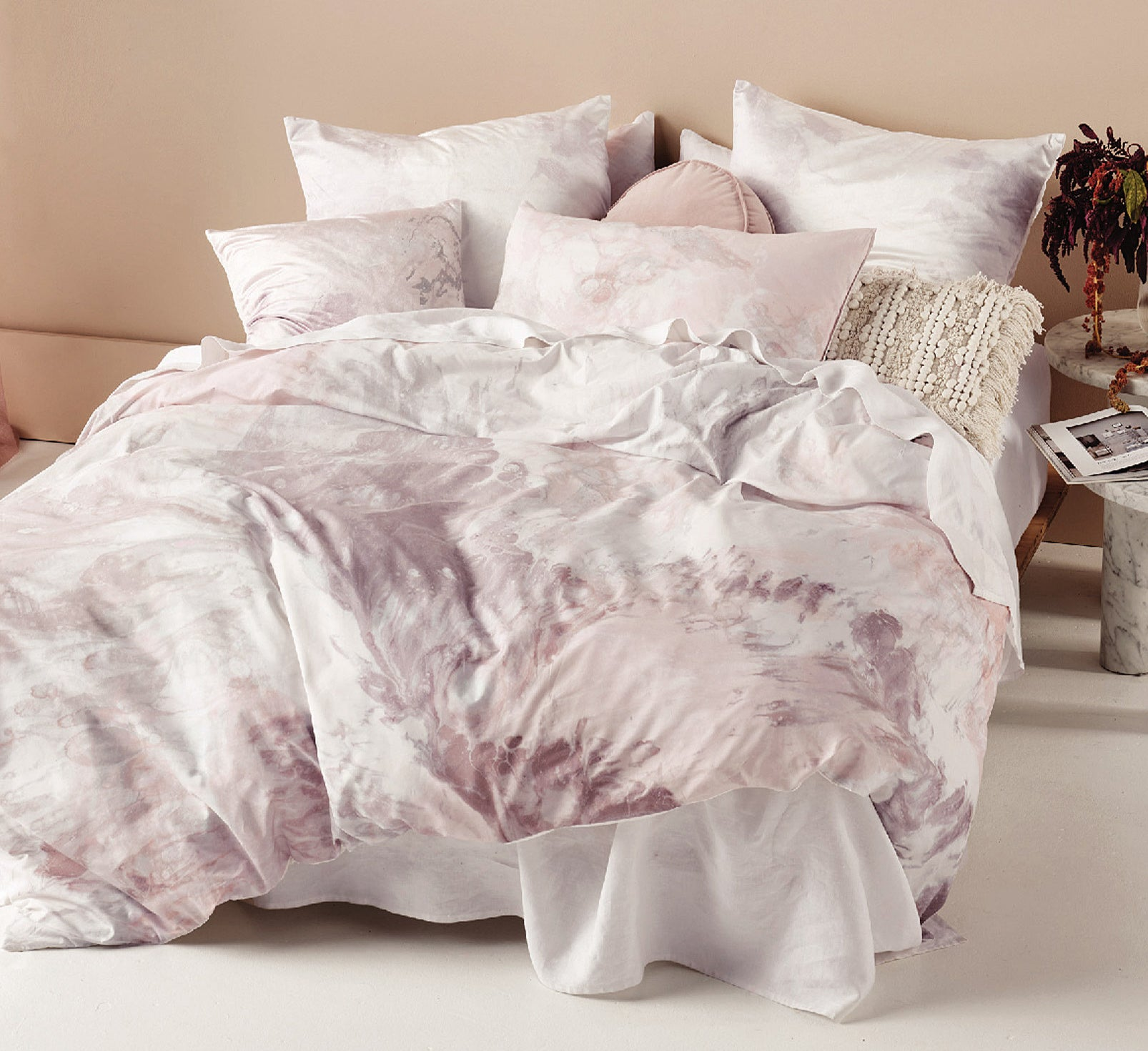 A duvet on a bed with tons of pillows on it