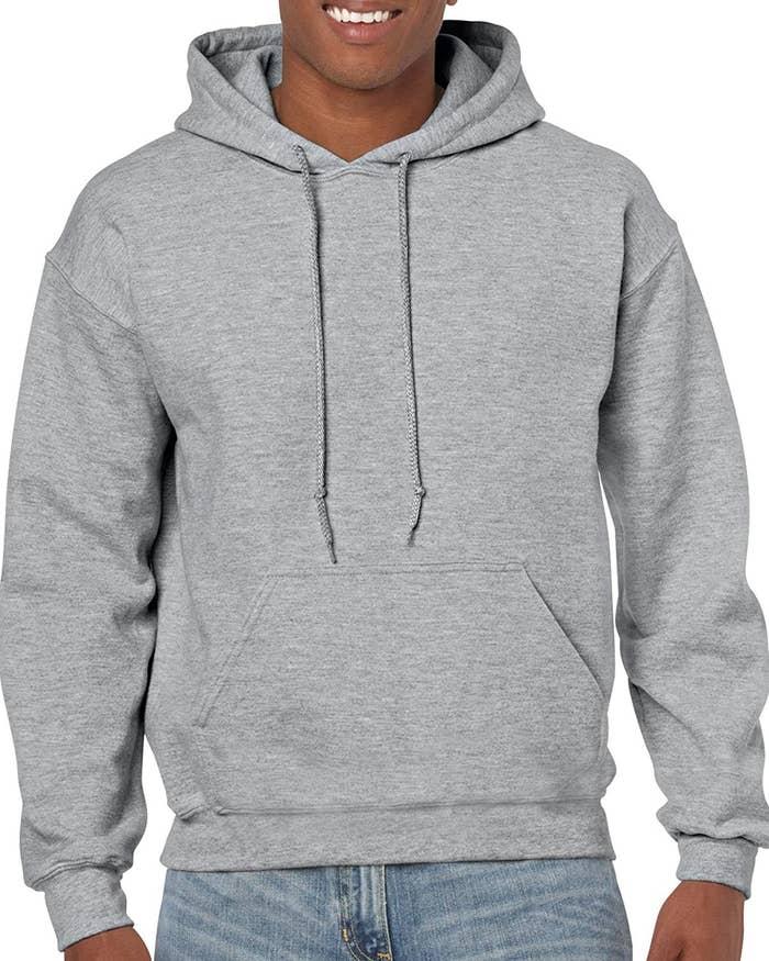 A model wearing the sweatshirt in gray.